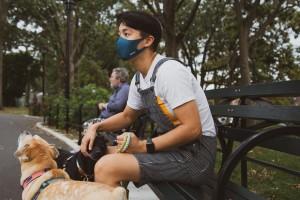 man mask dog walking